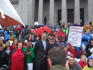 Governor Inslee speaking at the rally on the steps of the Capitol